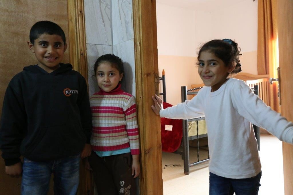 Image of Fhadad family - the lives of these children have been changed forever