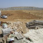 View of the surrounding site, including the recycled materials used and encircling apartheid wall