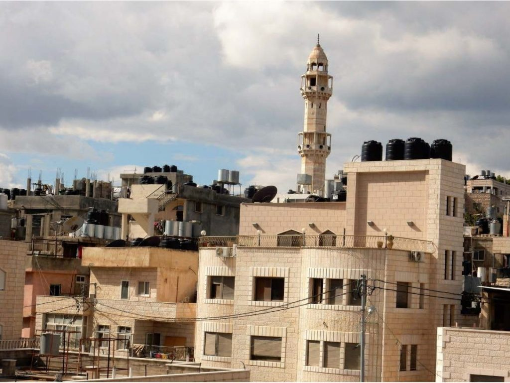 Another photo taken from the roof of the Aida Refugee Centre. The numerous black water tanks identify it as a Palestinian quarter that has taken precautionary measures against punitive water cut-offs.