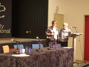 Linda passing the baton to Sara at ICAHD UK's conference